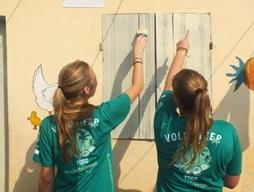 High School volunteer painting on a Care & Community High School Special program