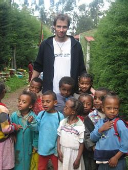 Volunteer with kids in Ethiopia