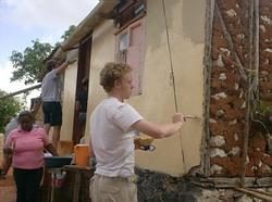 Volunteer painting a wall