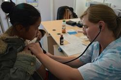 An Elective volunteer examines a patient in Mongolia