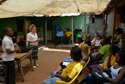 Volunteers in Ghana give a presentation on police brutality