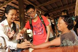 Projects Abroad Medicine volunteers treat local Cambodians during a medical outreach programme in Phnom Pehn
