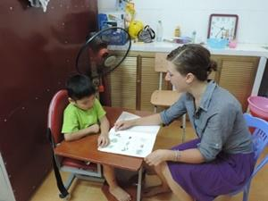 Female volunteer busy in a occupational therapy project in Vietnam, Asia