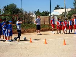 A volunteer coaches a local soccer team in Morocco
