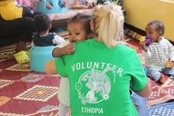 A Projects Abroad volunteers gives an Ethiopian child a hug at a placement in Addis Ababa.