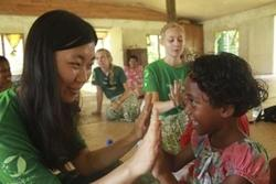 Projects Abroad Care volunteer with a local child at a placement in Fiji.